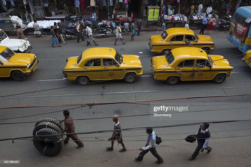 Taxis sit in traffic on a street in Kolkata, India, on Tuesday, Feb. 19, 2013. India's slowest economic expansion in a decade is limiting profit growth at the biggest companies even as foreigners remain net buyers of the nation's stocks, according to Kotak Institutional Equities. Photographer: Brent Lewin/Bloomberg via Getty Images
