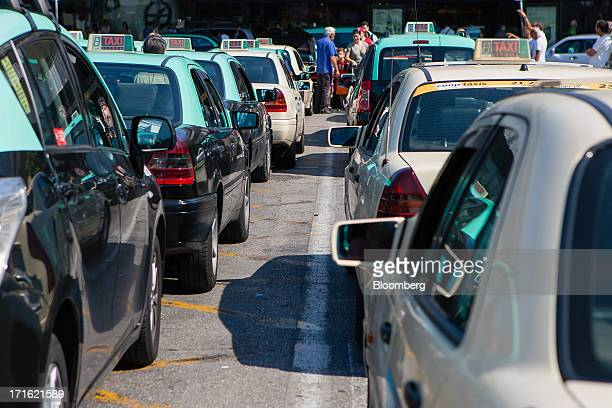 Taxis sit outside Lisbon International airport operated by ANAAeroportos de Portugal SA during a general strike in Lisbon Portugal on Thursday June...