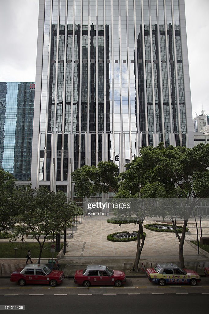 Taxis stand in front of the China Resources Building, which houses the headquarters of China Resources Holdings Co., in Hong Kong, China, on Monday, July 22, 2013. State-run China Resources Holdings's plan to combine two units did not survive a shareholder vote today, after the value of the $7.1 billion offer plunged following an accusation that the parent's chairman deliberately overpaid for coal mines in 2010. Photographer: Jerome Favre/Bloomberg via Getty Images
