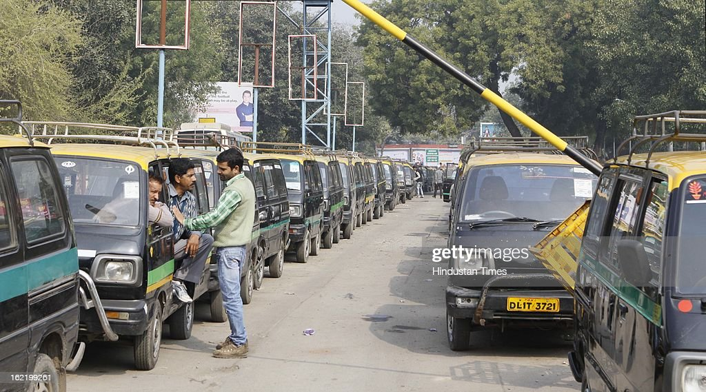 Taxis stand lined at Nizamudin Railway station as they remain off the road in support of 48 hour nationwide strike called by 11 Central Trade Unions on February 20, 2013 in New Delhi, India. The strike called against UPA's economic and alleged anti-labour policies crippled financial services like banks and insurance companies. Transport sector was partially hit by the strike as many bus, auto-rickshaw and taxi unions also extended their support.