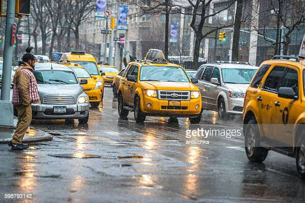 Taxis stuck in traffic under snow, NYC, USA