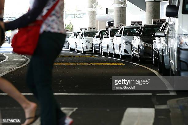 Taxi's wait for customers at Auckland International Airport on March 16 2016 in Auckland New Zealand New rules for taxi operators will see...