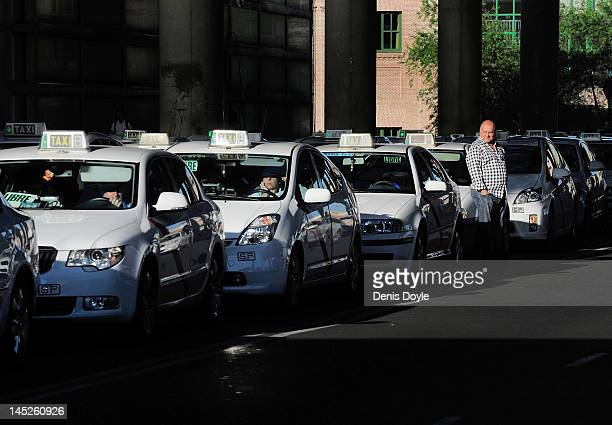 Taxis wait for customers outside Atocha train station on May 25 2012 in Madrid Spain Spain's ailing economy struggles to recover with the number of...