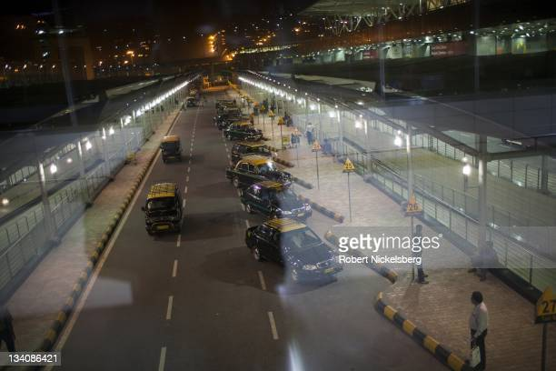 Taxis wait for passengers October 9 2011 at Terminal 3 of the Indira Gandhi International Airport in New Delhi India With the completion of the new...
