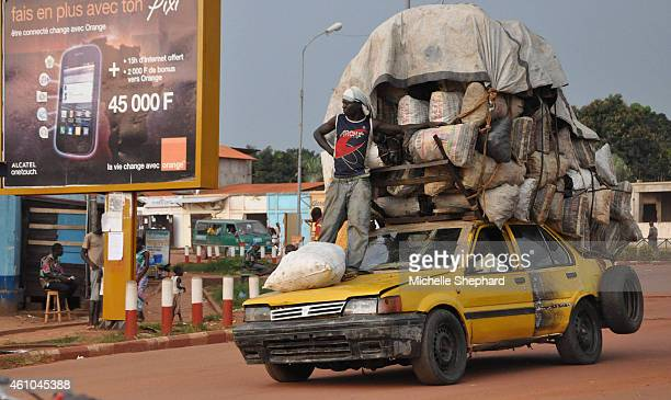 Taxis weighed down with belongings a common sight in CAR where few people have cars and there is often a fuel shortage