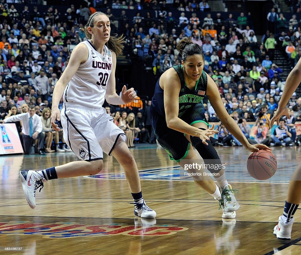 Taya Reimer #12 of the Notre Dame Fighting Irish dribbles against Breanna Stewart #30 of the Connecticut Huskies during the NCAA Women's Basketball Tournament Championship game at Bridgestone Arena on April 8, 2014 in Nashville, Tennessee.