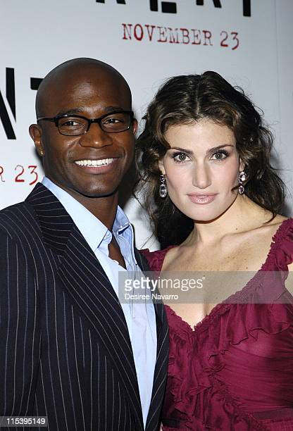 Taye Diggs and Idina Menzel during ''Rent'' New York City Premiere Arrivals at Ziegfeld Theater in New York City New York United States