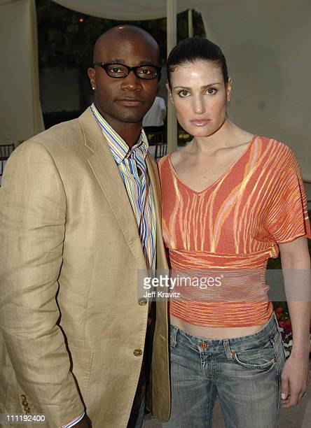 Taye Diggs and wife Idina Menzel during 'The Comeback' HBO Los Angeles Premiere Arrivals at Paramount Theater in Los Angeles California United States