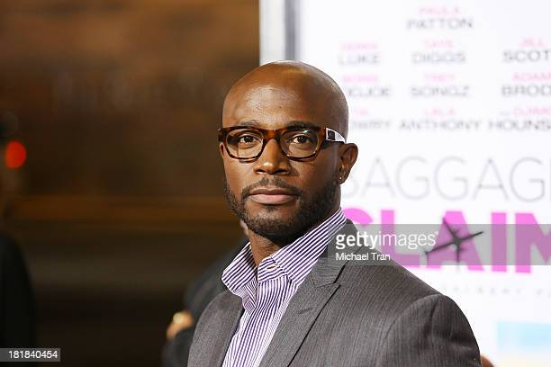 Taye Diggs arrives at the Los Angeles premiere of 'Baggage Claim' held at Regal Cinemas LA Live on September 25 2013 in Los Angeles California