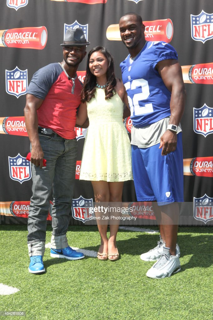 Taye Diggs Lianah Sta Ana and Jon Beason attend Duracell Interactive Tour Of MetLife Stadium at MetLife Stadium on August 27 2014 in East Rutherford...