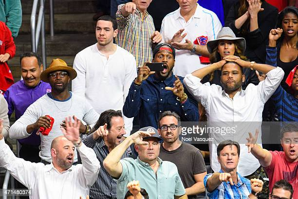 Taye Diggs Van Lathan and Anthony Anderson attend a basketball game between the San Antonio Spurs and the Los Angeles Clippers at Staples Center on...