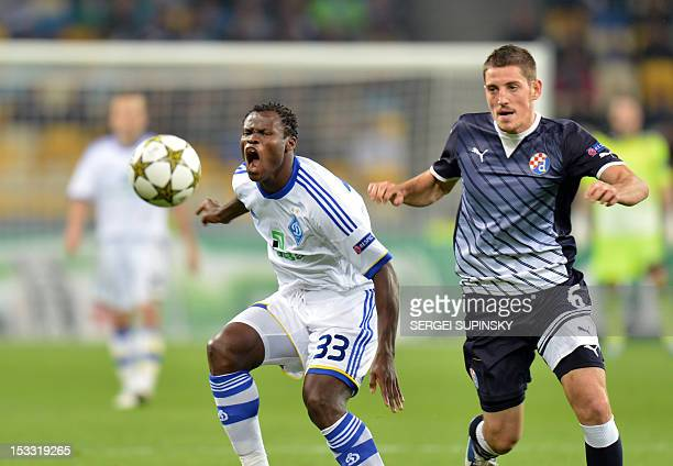 Taye Taiwo of FC Dynamo Kiev fights for a ball with Arijan Ademi of GNK Dinamo Zagreb during UEFA Champions League Group A football match in Kiev on...
