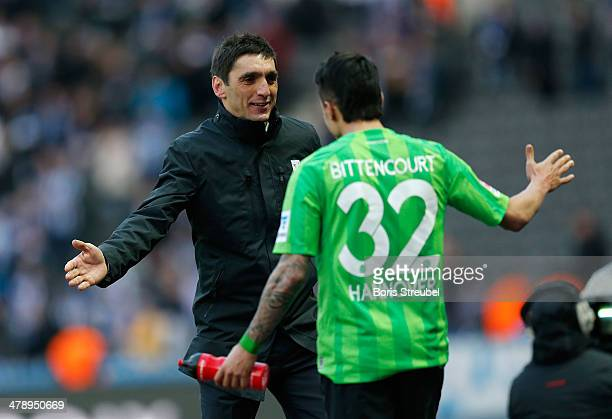Tayfun Korkut head coach of Hannover and team mate Leonardo Bittencourt celebrate after winning the Bundesliga match between Hertha BSC and Hannover...