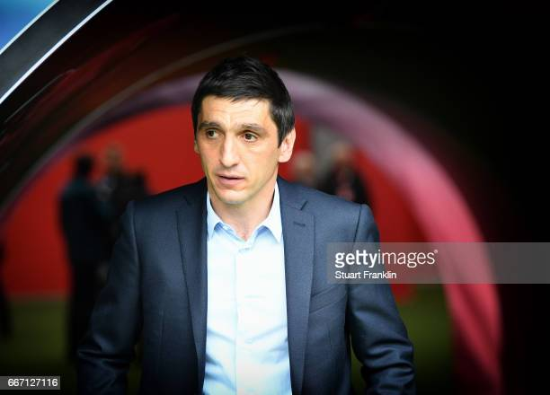 Tayfun Korkut head coach of Leverkusen looks on during the Bundesliga match between RB Leipzig and Bayer 04 Leverkusen at Red Bull Arena on April 8...