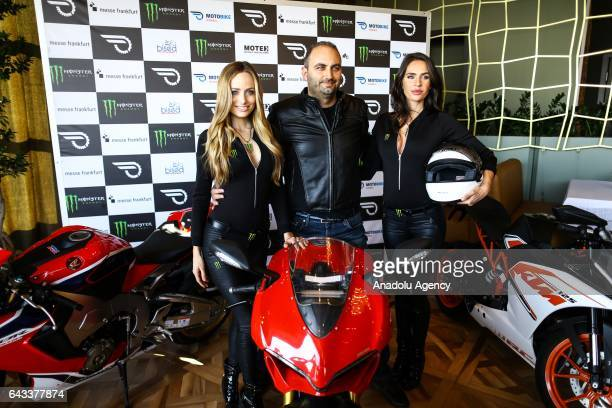 Tayfun Yardim Managing Director of Messe Frankfurt Istanbul poses for a photo with models during an introductory meeting of Motobike exhibition...