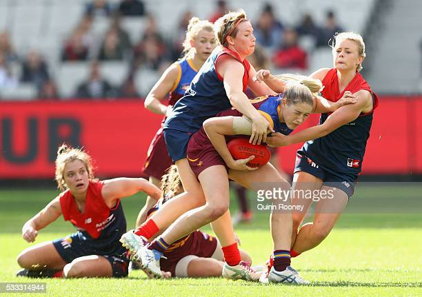 Tayla Harris of Queensland is tackled by Jessica Cameron of Melbourne during the women's AFL exhibition match between Melbourne and Queensland at...