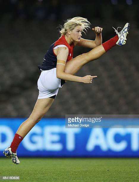 Tayla Harris of the Demons kicks the ball for a goal during a Women's AFL exhibition match between Western Bulldogs and Melbourne at Etihad Stadium...