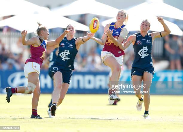 Tayla Harris of the Lions competes for the ball with Alison Downie and Kate GillespieJones of the Blues during the 2017 AFLW Round 07 match between...