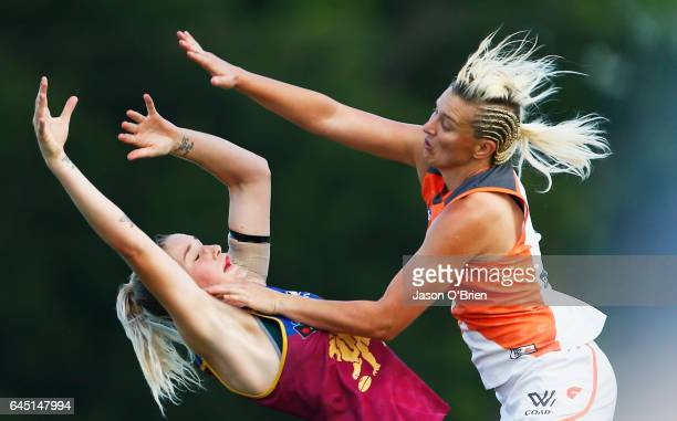 Tayla Harris of the Lions in action with Renee Tomkins of the Giants during the round four Women's AFL match between the Brisbane Lions and the...