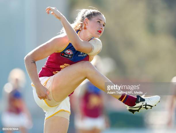 Tayla Harris of the Lions kicks the ball during the 2017 AFLW Round 07 match between the Carlton Blues and the Brisbane Lions at Ikon Park on March...