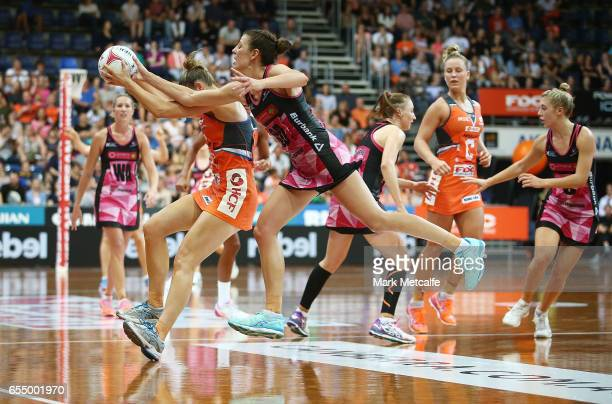 Taylah Davies of the Giants and Fiona Ehemann of the Thunderbirds contest possession during the round five Super Netball match between the Giants and...