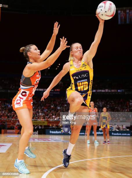 Taylah Davies of the Giants competes with Laura Langman of the Lightning during the round 14 Super Netball match between the Giants and the Lightning...