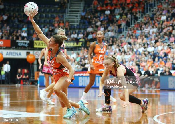 Taylah Davies of the Giants stumbles as she contests posession with Jade Clarke of the Thunderbirds during the round five Super Netball match between...