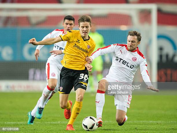 Taylan Duman of Duesseldorf Niklas Hauptmann of Dresden and Adam Bodzek of Duesseldorf in action during the Second Bundesliga match between Fortuna...