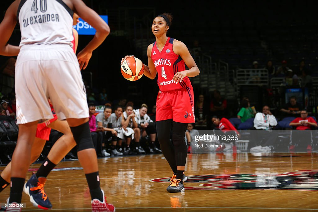 Tayler Hill #4 of the Washington Mystics dribbles the ball against the San Antonio Stars on June 29, 2016 at the Verizon Center in Washington, DC.