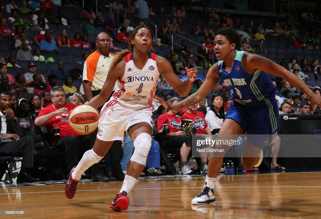<a gi-track='captionPersonalityLinkClicked' href=/galleries/search?phrase=Tayler+Hill&family=editorial&specificpeople=5791962 ng-click='$event.stopPropagation()'>Tayler Hill</a> #4 of the Washington Mystics drives against Kamiko Williams #4 of the New York Liberty at the Verizon Center on September 15, 2013 in Washington, DC.