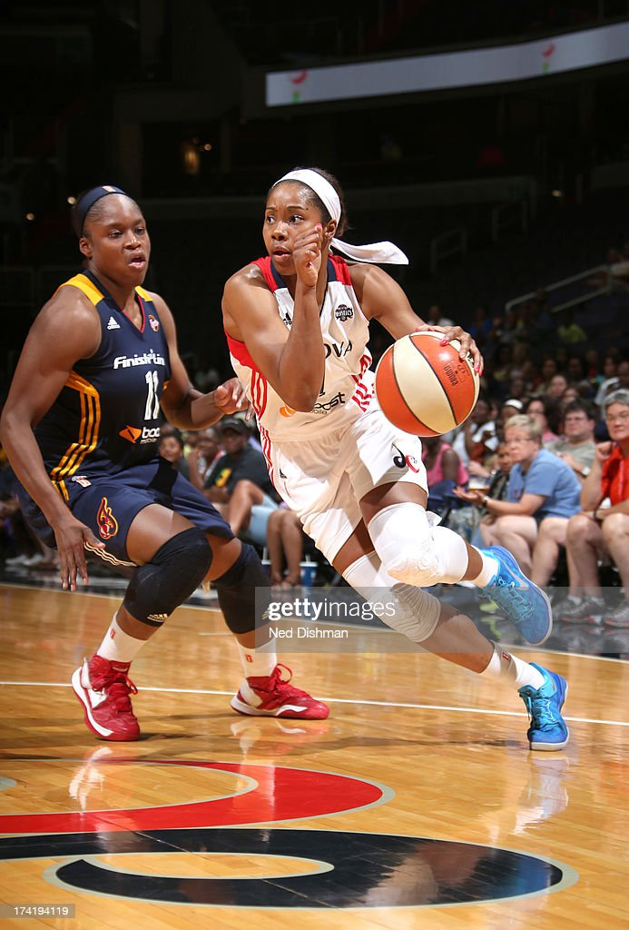 <a gi-track='captionPersonalityLinkClicked' href=/galleries/search?phrase=Tayler+Hill&family=editorial&specificpeople=5791962 ng-click='$event.stopPropagation()'>Tayler Hill</a> #4 of the Washington Mystics drives against Karima Christmas #11 of the Indiana Fever at the Verizon Center on July 21, 2013 in Washington, DC.