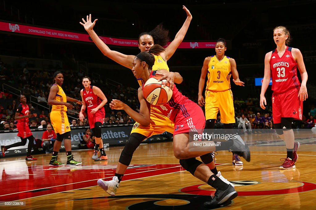 Tayler Hill #4 of the Washington Mystics drives to the basket against the Los Angeles Sparks on May 20, 2016 at the Verizon Center in Washington, DC.