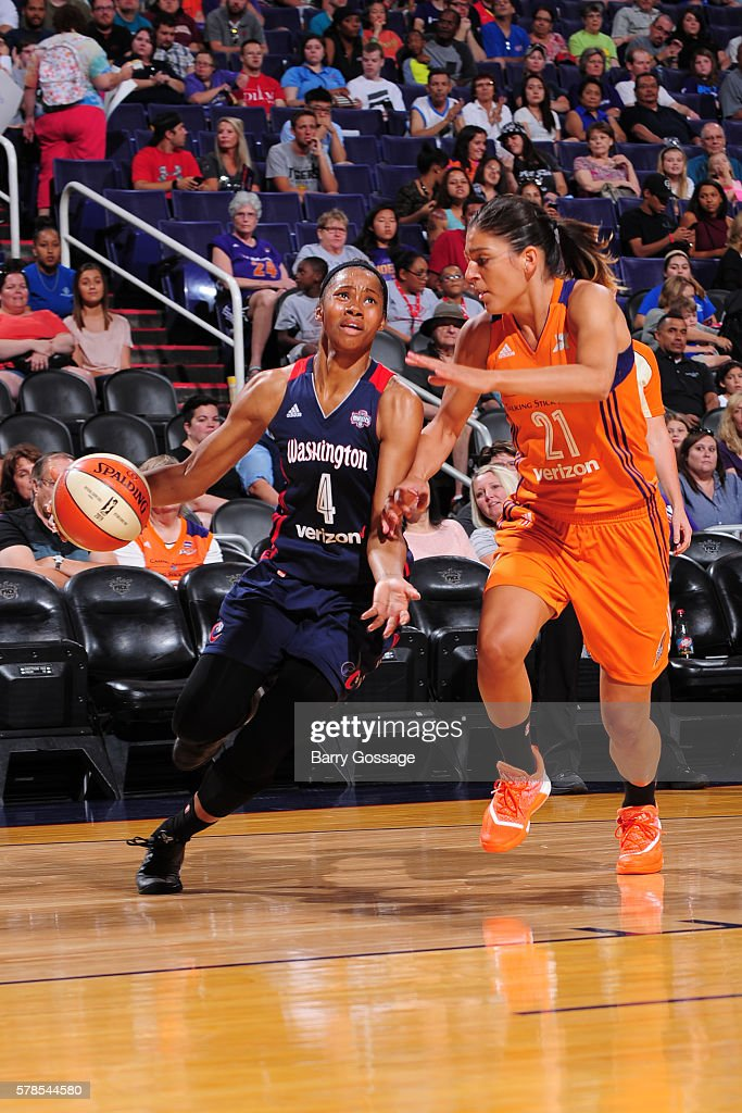 Tayler Hill of the Washington Mystics drives to the basket against Marta Xargay of the Phoenix Mercury on July 13 2016 at Talking Stick Resort Arena...