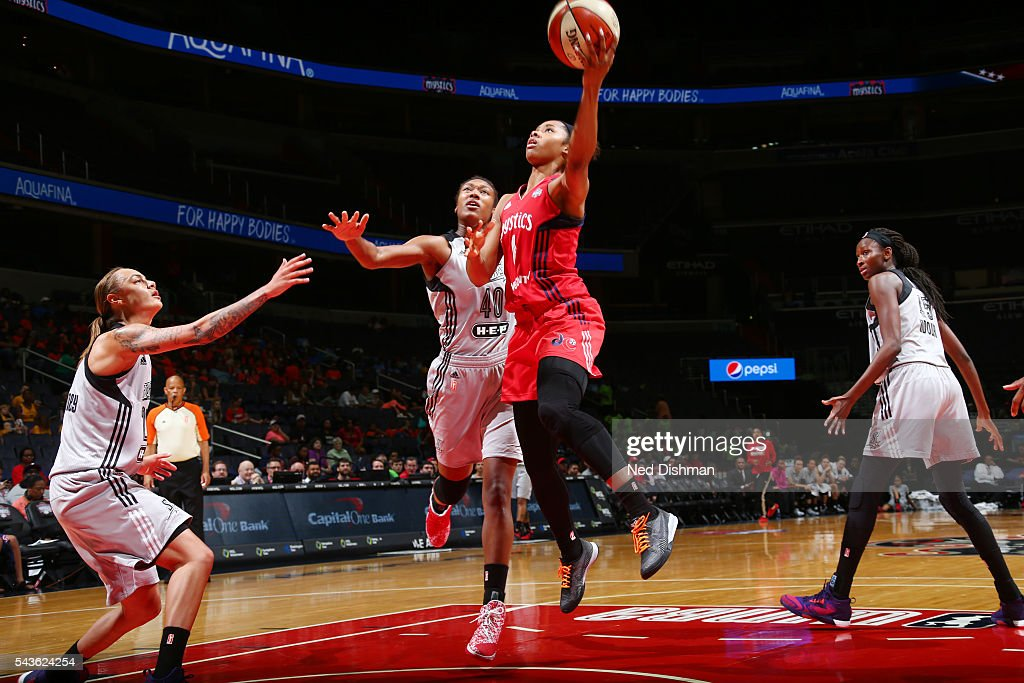 Tayler Hill #4 of the Washington Mystics goes for a layup against the San Antonio Stars on June 29, 2016 at the Verizon Center in Washington, DC.
