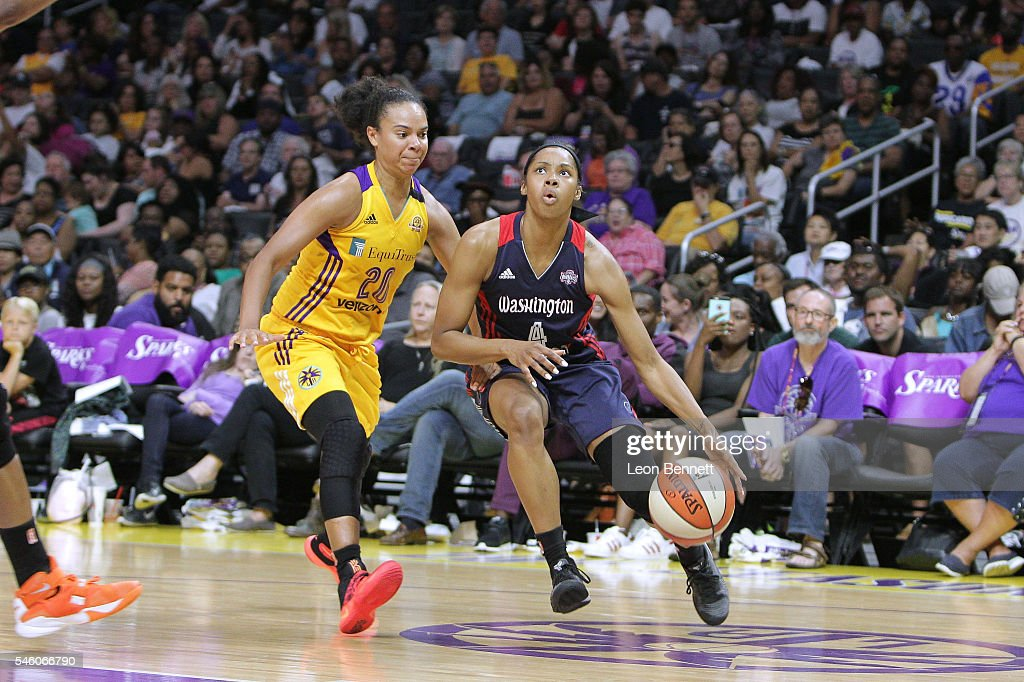Tayler Hill of the Washington Mystics handles the ball against Kristi Toliver of the Los Angeles Sparks during a WNBA basketball game at Staples...