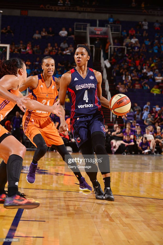 Tayler Hill of the Washington Mystics handles the ball against DeWanna Bonner of the Phoenix Mercury on July 13 2016 at Talking Stick Resort Arena in...