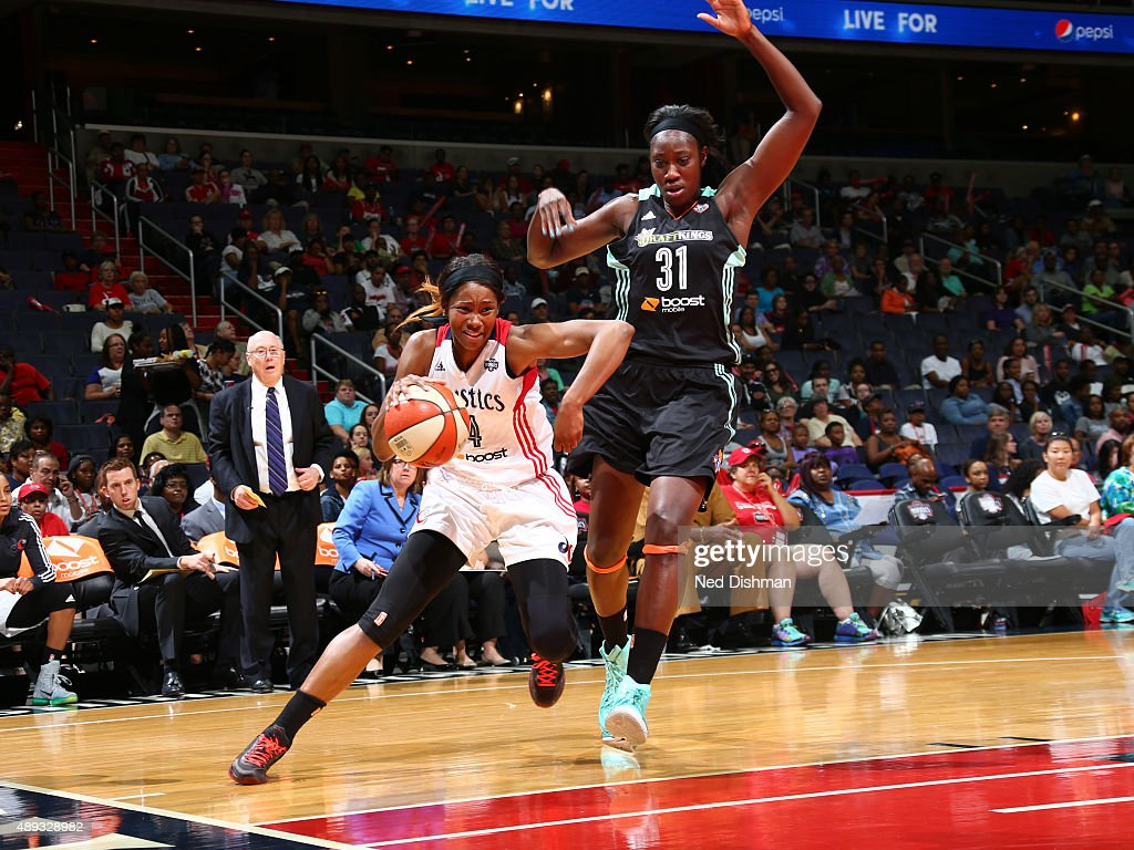 Tayler Hill of the Washington Mystics handles the ball against Tina Charles of the New York Liberty in Game Two of the WNBA Western Conference...