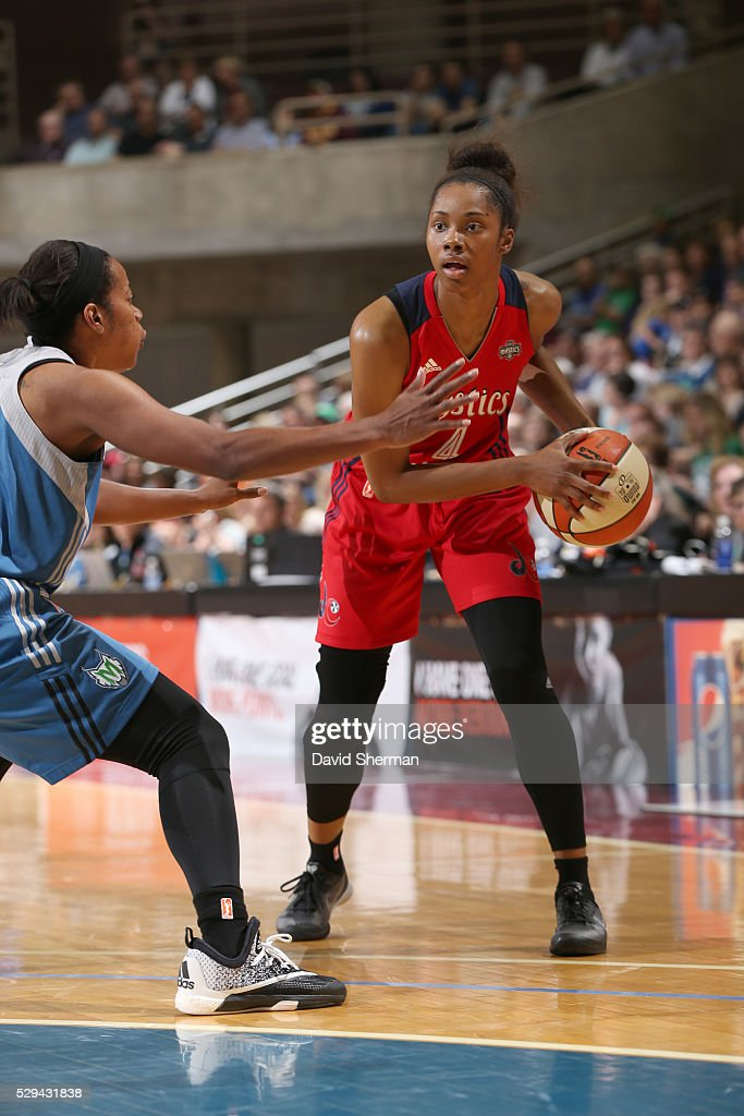 Tayler Hill #4 of the Washington Mystics looks to pass against Jia Perkins #7 of the Minnesota Lynx during the preseason game on May 8, 2016 at the Mayo Civic Center in Rochester, Minnesota.