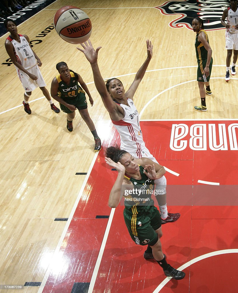 <a gi-track='captionPersonalityLinkClicked' href=/galleries/search?phrase=Tayler+Hill&family=editorial&specificpeople=5791962 ng-click='$event.stopPropagation()'>Tayler Hill</a> #4 of the Washington Mystics shoots against Alysha Clark #32 of the Seattle Storm at the Verizon Center on July 6, 2012 in Washington, DC.