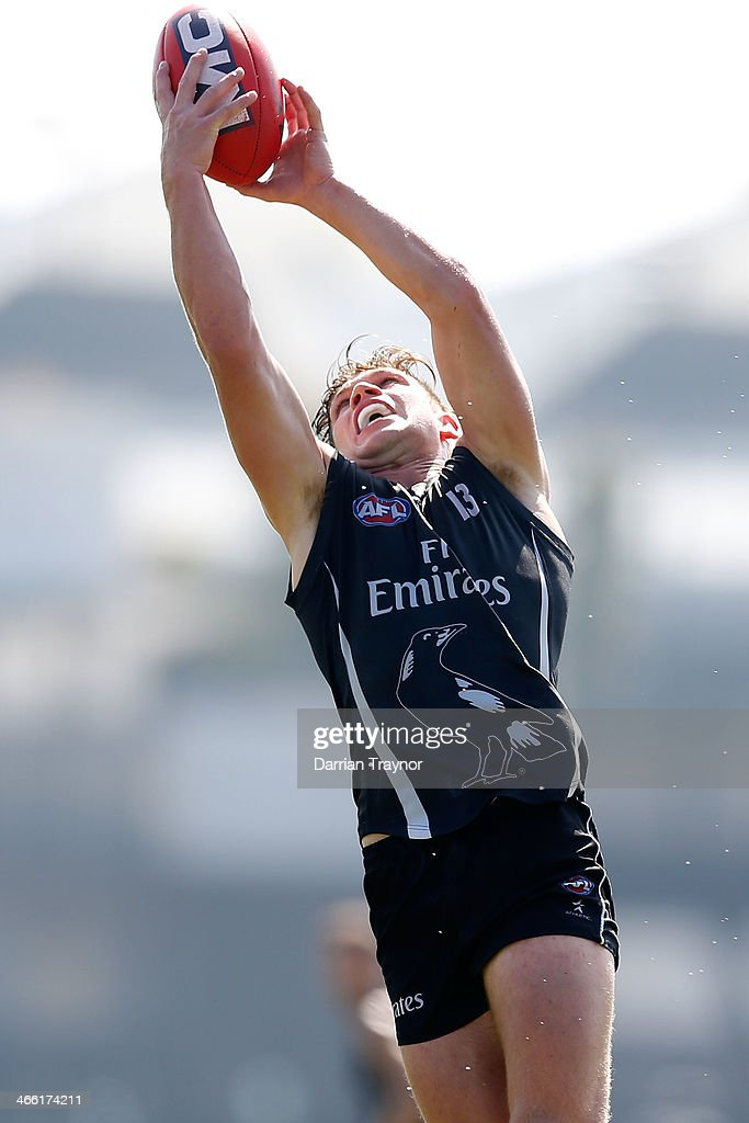Taylor Adams marks the ball during a Collingwood Magpies AFL pre-season intra-club match at Olympic Park on February 1, 2014 in Melbourne, Australia.
