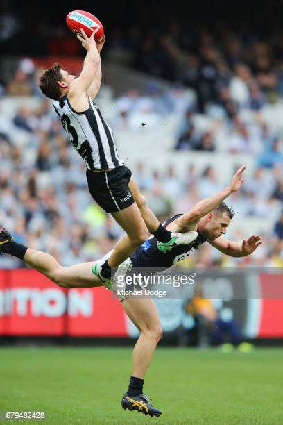 Taylor Adams of the Magpies marks the ball high over Sam Docherty of the Blues during the round seven AFL match between the Collingwood Magpies and...