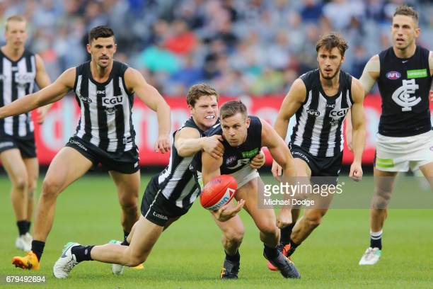 Taylor Adams of the Magpies tackles Sam Docherty of the Blues during the round seven AFL match between the Collingwood Magpies and the Carlton Blues...