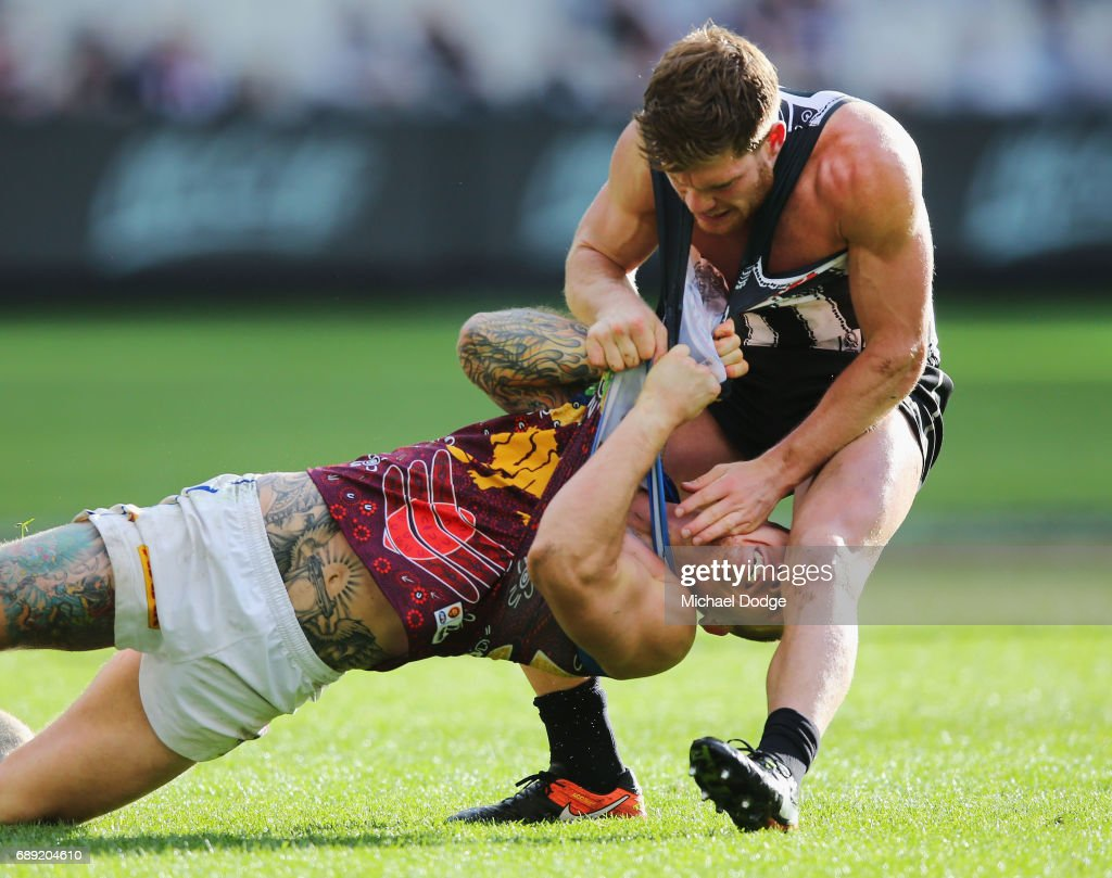 Taylor Adams of the Magpies wrestles on top of Dayne Beams of the Lions during the round 10 AFL match between the Collingwood Magpies and Brisbane Lions at Melbourne Cricket Ground on May 28, 2017 in Melbourne, Australia.
