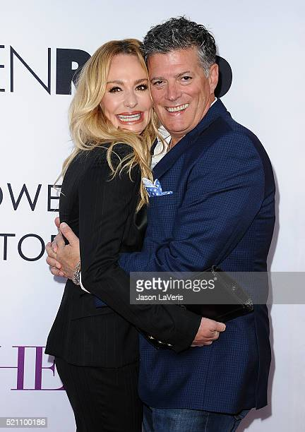 Taylor Armstrong and husband John H Bluher attend the premiere of 'Mother's Day' at TCL Chinese Theatre IMAX on April 13 2016 in Hollywood California