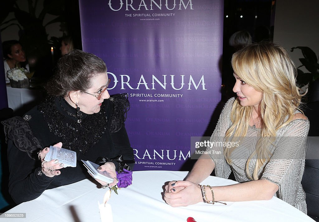Taylor Armstrong (R) gets a psychic reading at the 'How Lavish Will Your 2013 Be?' event held at Sur Restaurant on January 15, 2013 in Los Angeles, California.