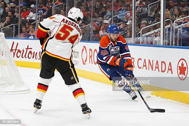 Taylor Beck of the Edmonton Oilers skates against Rasmus Andersson of the Calgary Flames during a preseason NHL game on September 26 2016 at Rogers...