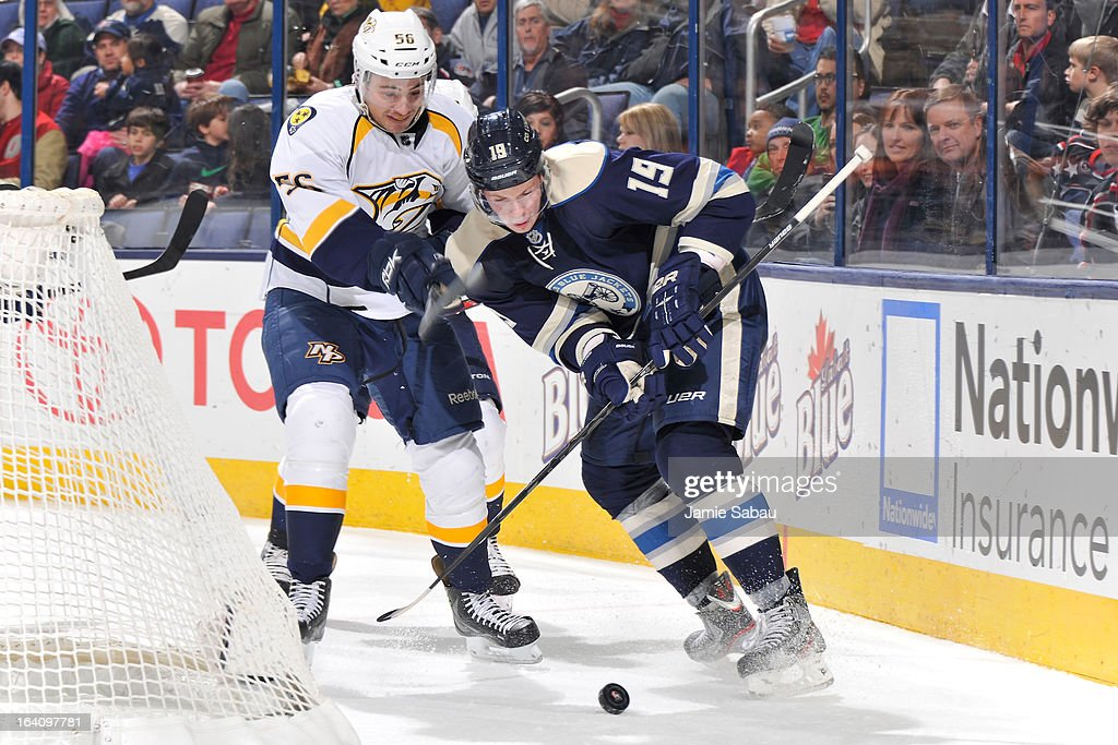 Taylor Beck #56 of the Nashville Predators and <a gi-track='captionPersonalityLinkClicked' href=/galleries/search?phrase=Ryan+Johansen&family=editorial&specificpeople=6698841 ng-click='$event.stopPropagation()'>Ryan Johansen</a> #19 of the Columbus Blue Jackets battle for the puck during the second period on March 19, 2013 at Nationwide Arena in Columbus, Ohio.