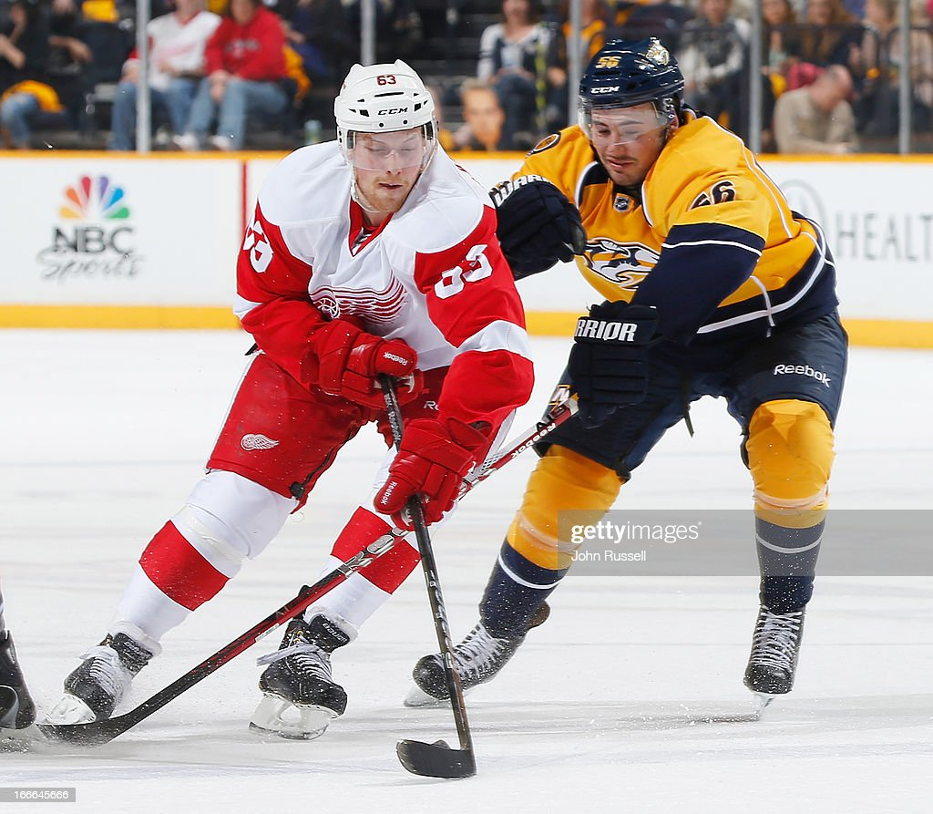 Taylor Beck #56 of the Nashville Predators battles for the puck against Joakim Andersson #63 of the Detroit Red Wings during an NHL game at the Bridgestone Arena on April 14, 2013 in Nashville, Tennessee.