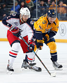 Taylor Beck of the Nashville Predators battles for the puck against Artem Anisimov of the Columbus Blue Jackets at Bridgestone Arena on November 29...