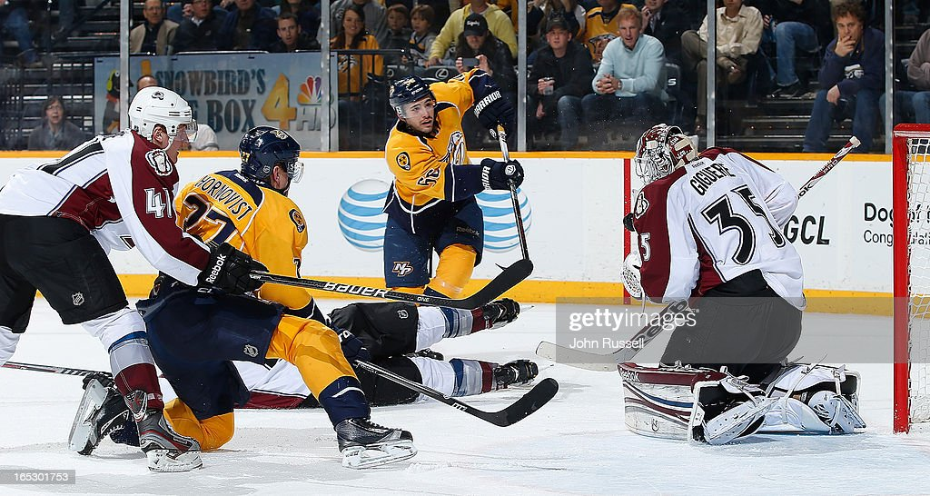 Taylor Beck #56 of the Nashville Predators has his shot stopped against <a gi-track='captionPersonalityLinkClicked' href=/galleries/search?phrase=Jean-Sebastien+Giguere&family=editorial&specificpeople=202814 ng-click='$event.stopPropagation()'>Jean-Sebastien Giguere</a> #35 of the Colorado Avalanche during an NHL game at the Bridgestone Arena on April 2, 2013 in Nashville, Tennessee.